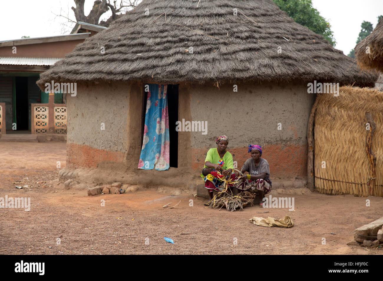 Koumban village, Guinea, 2nd May 2015; Saran Condé, 40, and Nafina Dioubaté ,78,  shelling Néré - Stock Image