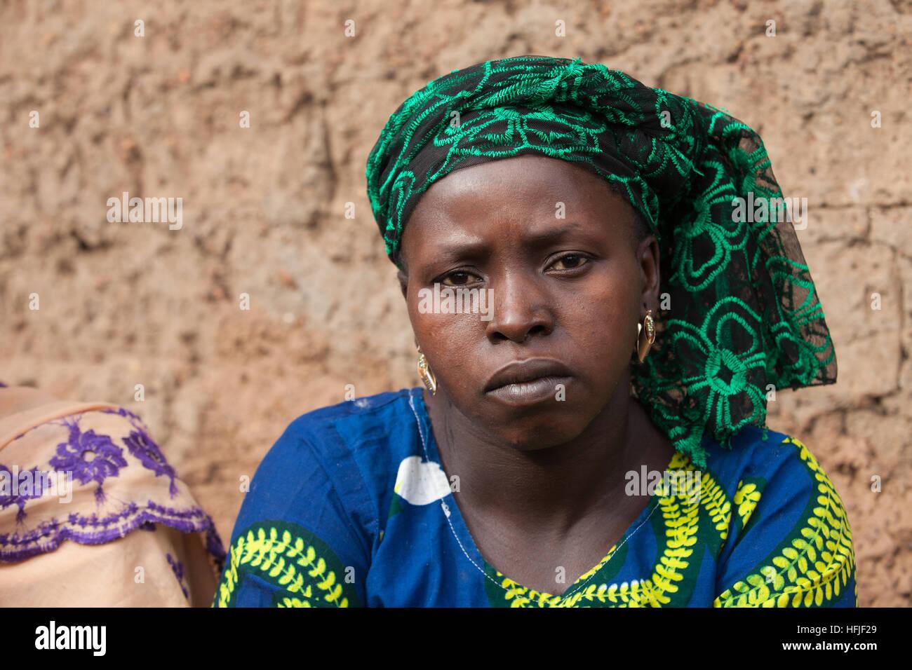 Koumban village, Guinea, 2nd May 2015; Sona Sacko, 75,  and her daughter Tenein Doumbouya, 35, are Shea butter sellers. - Stock Image
