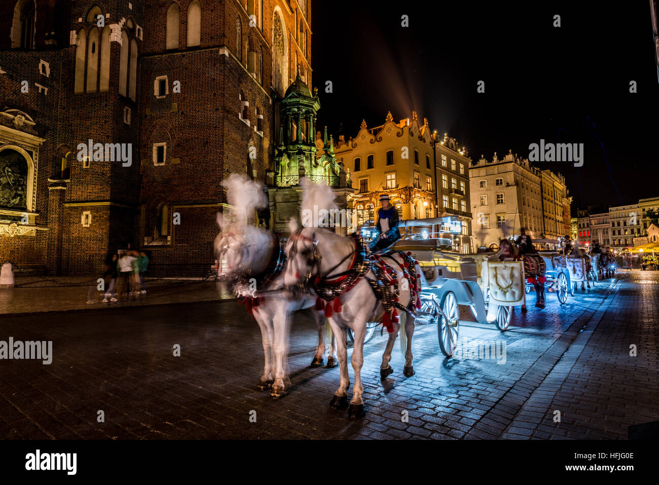 The 13th century main square of the Old Town of Kraków, is the principal urban space  is one of the larges - Stock Image