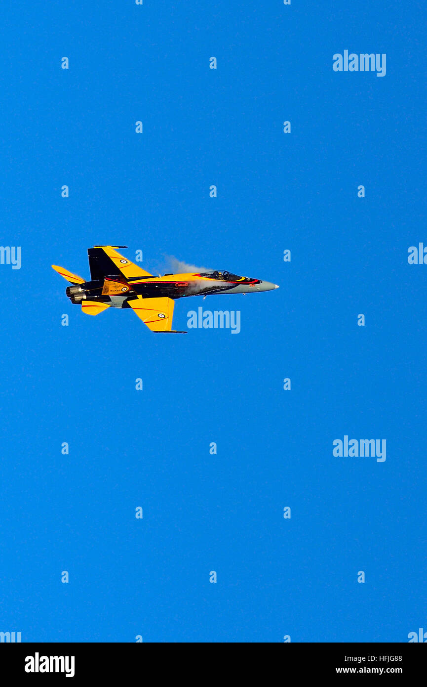 A vertical image of a Canadian Air Force CF-18 Hornet jet fighter airplane - Stock Image