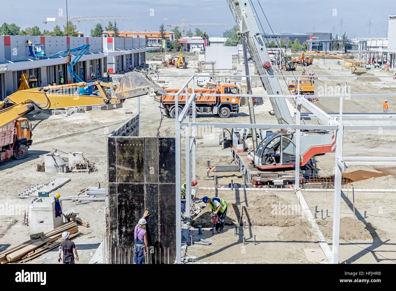 View on building site until workers are assembly a huge mold for concreting. Stock Photo