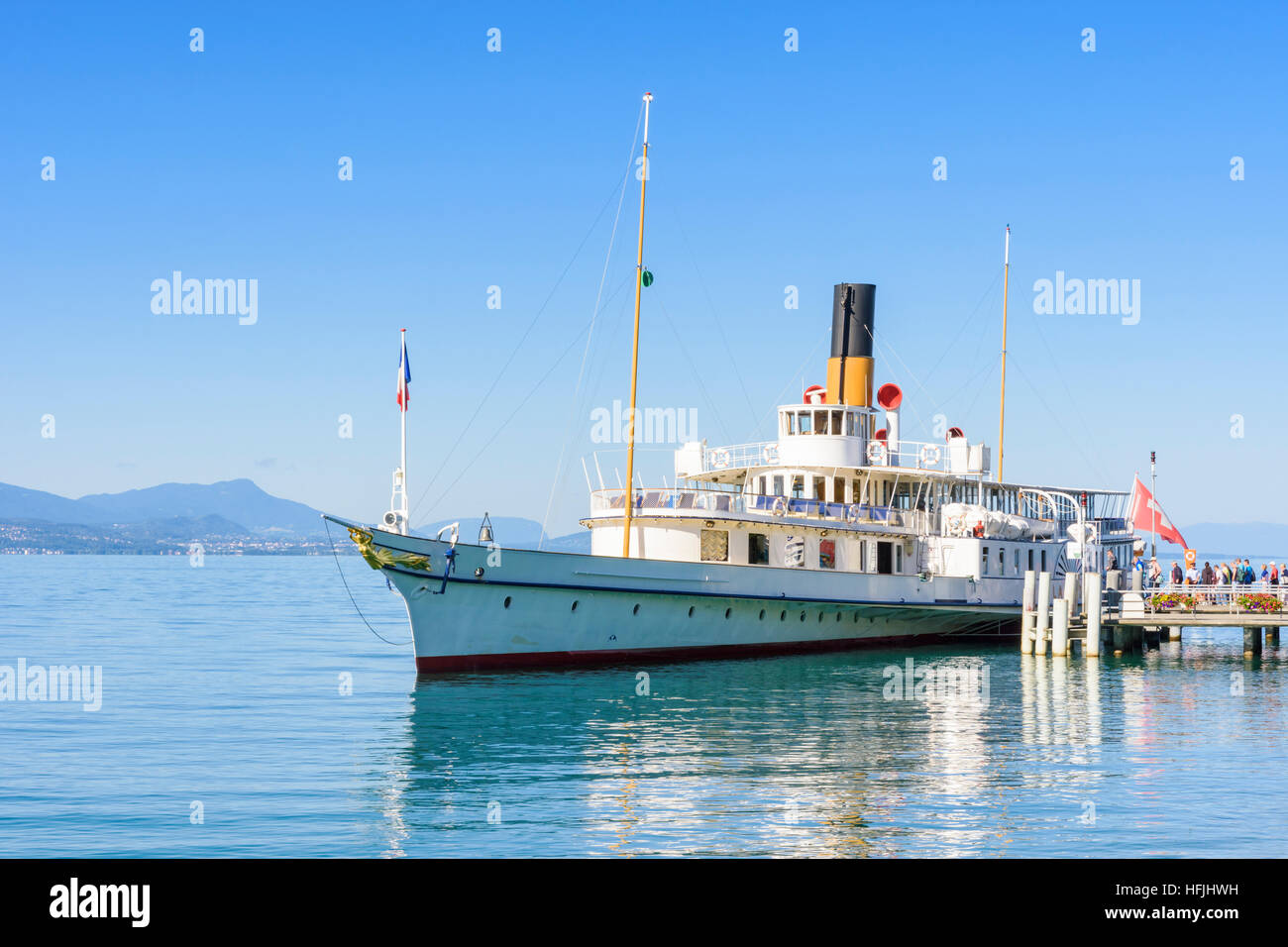 The Belle Epoque paddle steamer La Suisse moored in Ouchy with passengers boarding, Lausanne, Switzerland - Stock Image