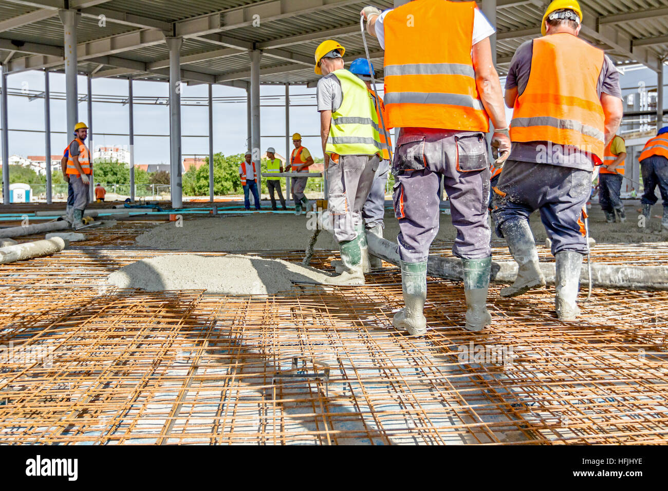 Zrenjanin, Vojvodina, Serbia - May 29, 2015: Construction workers are pouring concrete in building foundation, directing Stock Photo