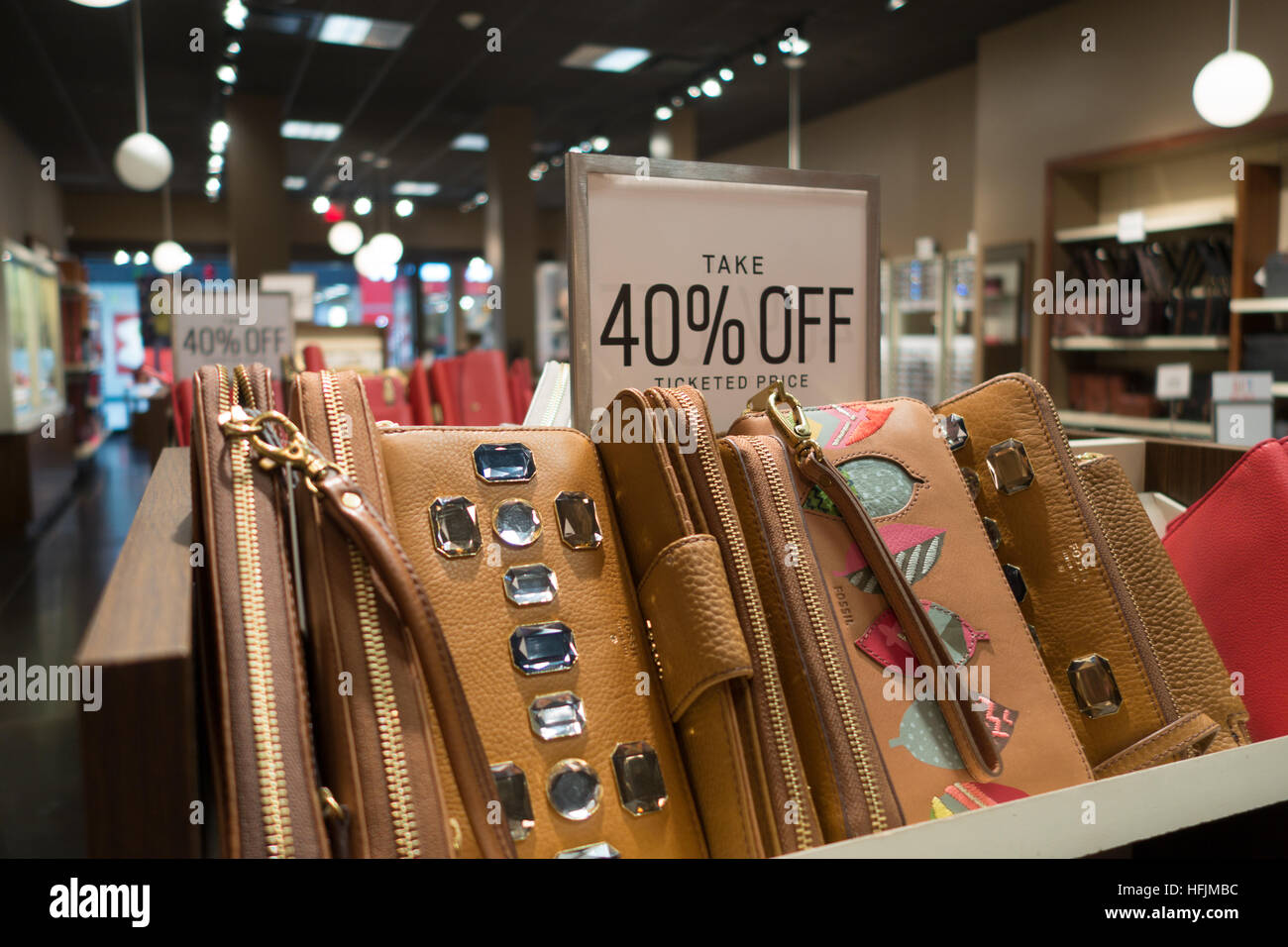 ladies clutch bags sale inside store - Stock Image