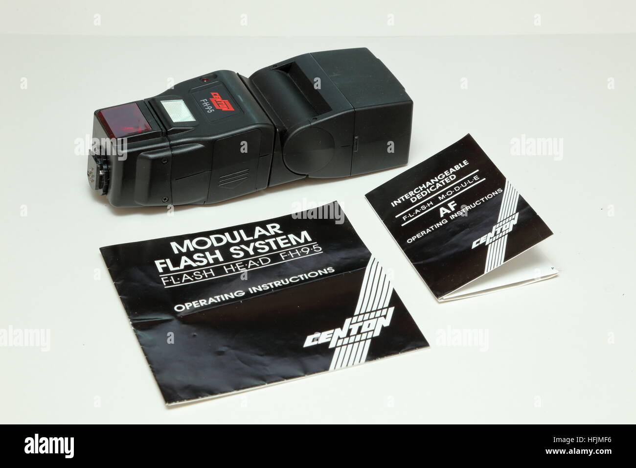 Centon (Jessops) FH95 electronic flashgun displayed with instruction booklets from 1990s - Stock Image