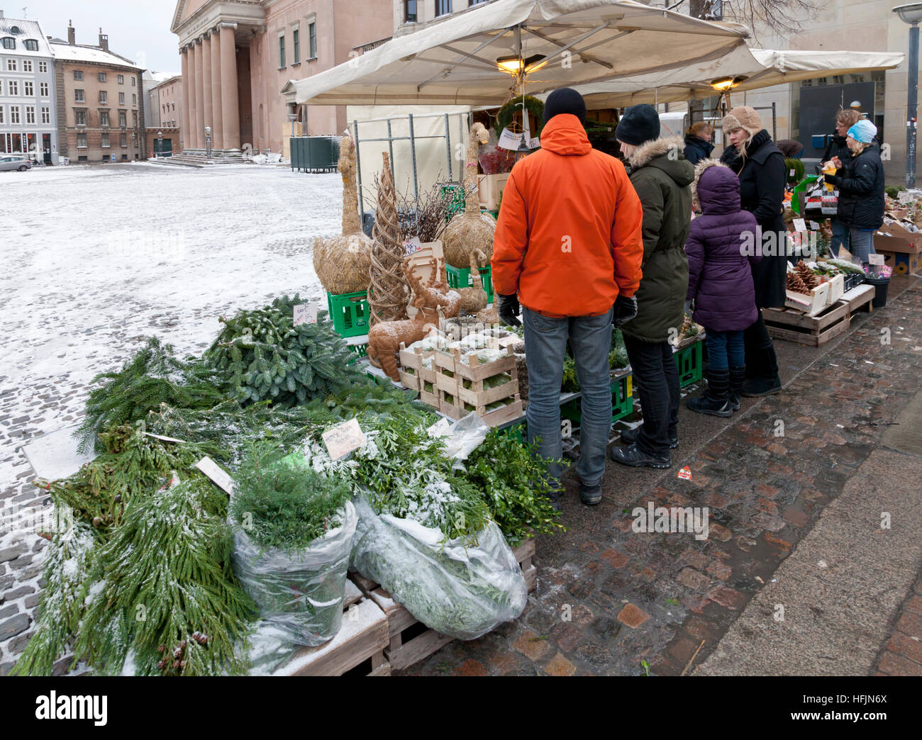The fruit stall at Nytorv on Strøget in Copenhagen sells Christmas decorative greenery, cones, straw goats, - Stock Image