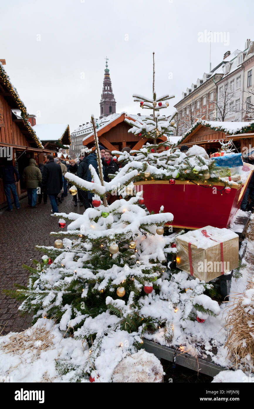Decorated Christmas trees with snow at Christmas market in Højbro Plads, Hoejbro Square, on Strøget, Stroeget, - Stock Image