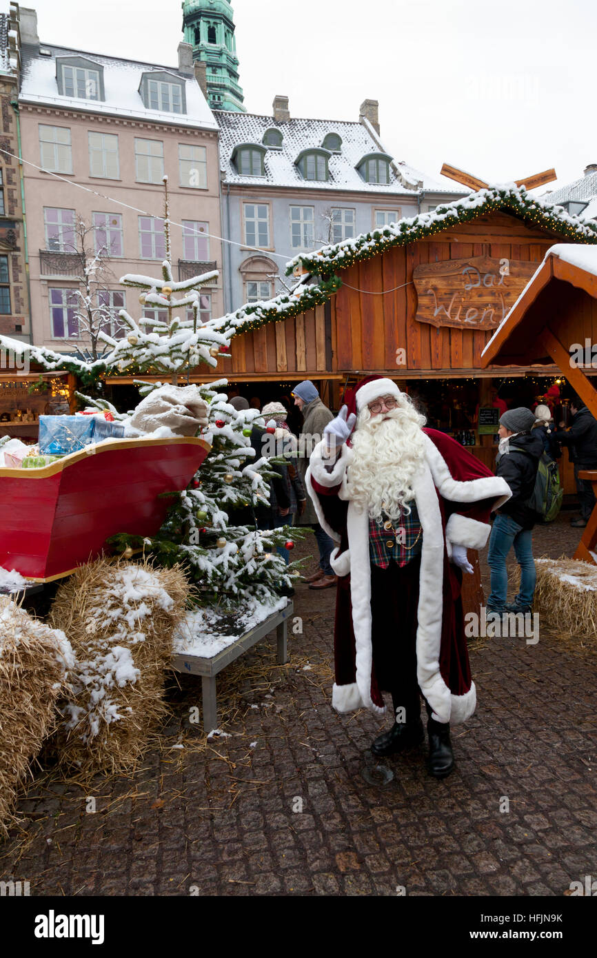 Santa Claus and sleigh at the Christmas market at Højbro Plads, Hoejbro Square, at Strøget in Copenhagen. - Stock Image