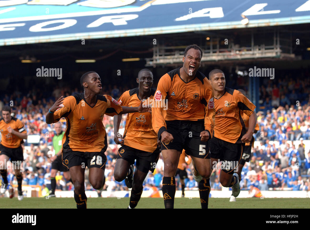 Footballer Joleon Lescott celebrates after scoring a goal for Wolves FC against Cardiff 2005 - Stock Image
