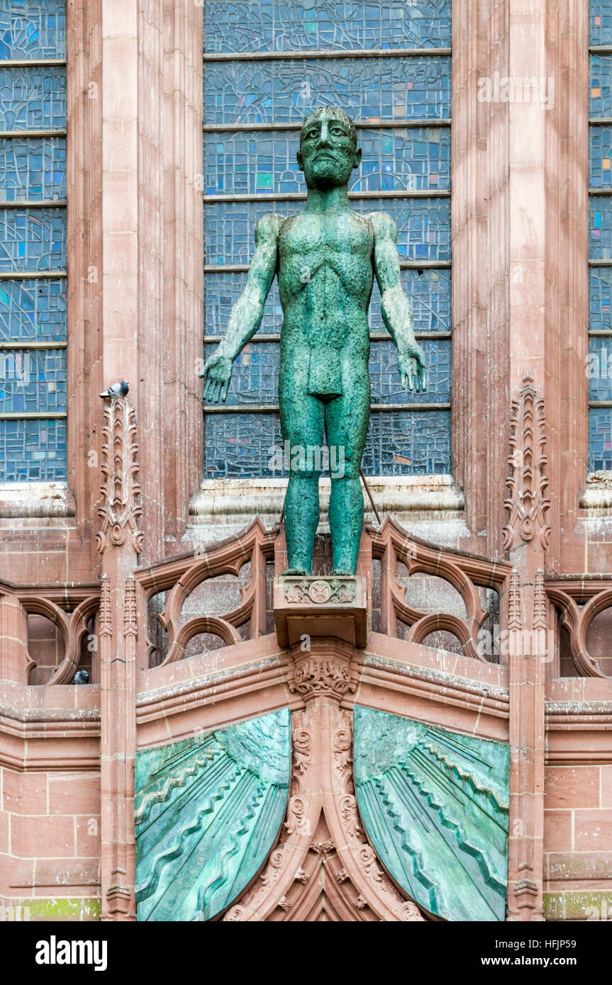 The Welcoming Christ by Elisabeth Frink above the West Door to the Anglican Liverpool Cathedral. Bronze. 1993. - Stock Image