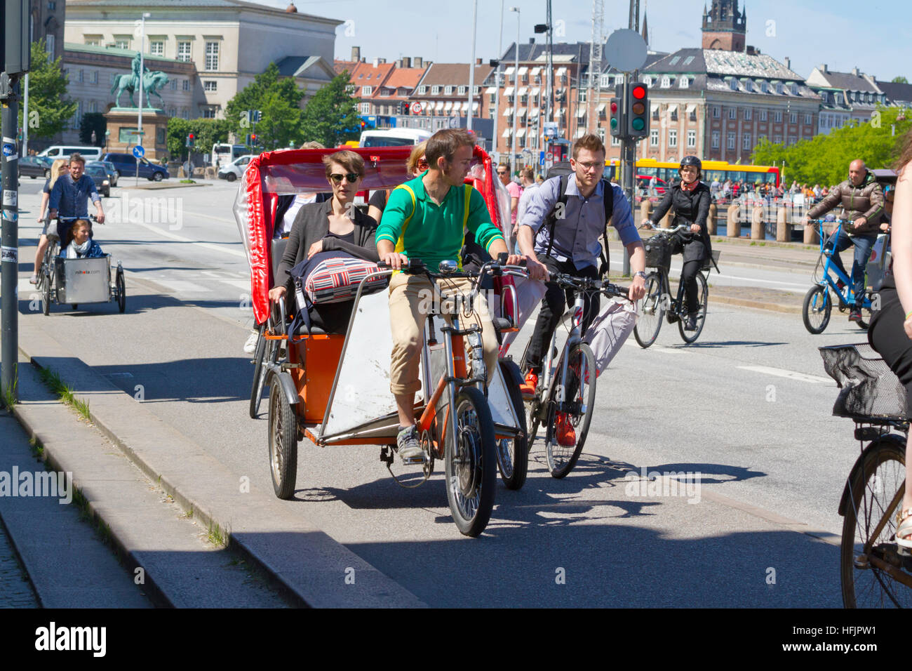 A close call on busy cycle lane on Børsgade in central Copenhagen. Bicycle cabs and cargo bikes take up a lot - Stock Image