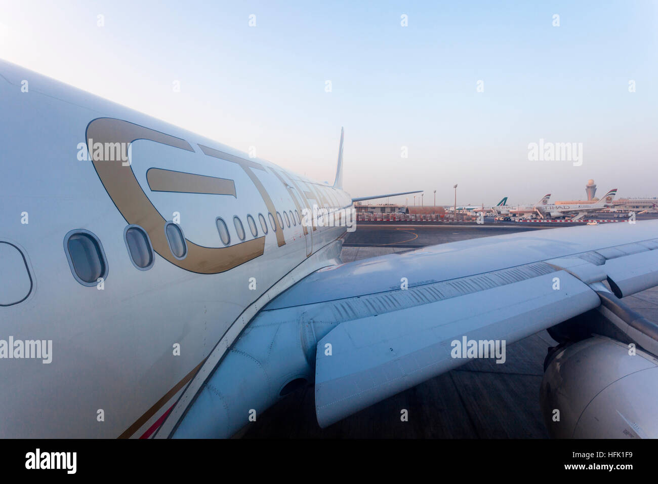 Etihad Airlines aircraft at the runway of the Abu Dhabi International Airport - Stock Image