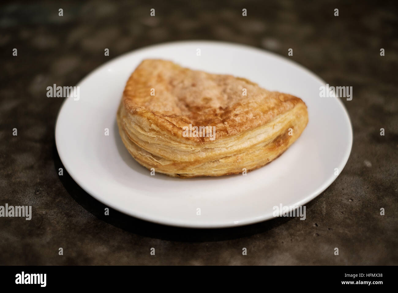 Baked apple puff turnover pastry in dish. - Stock Image