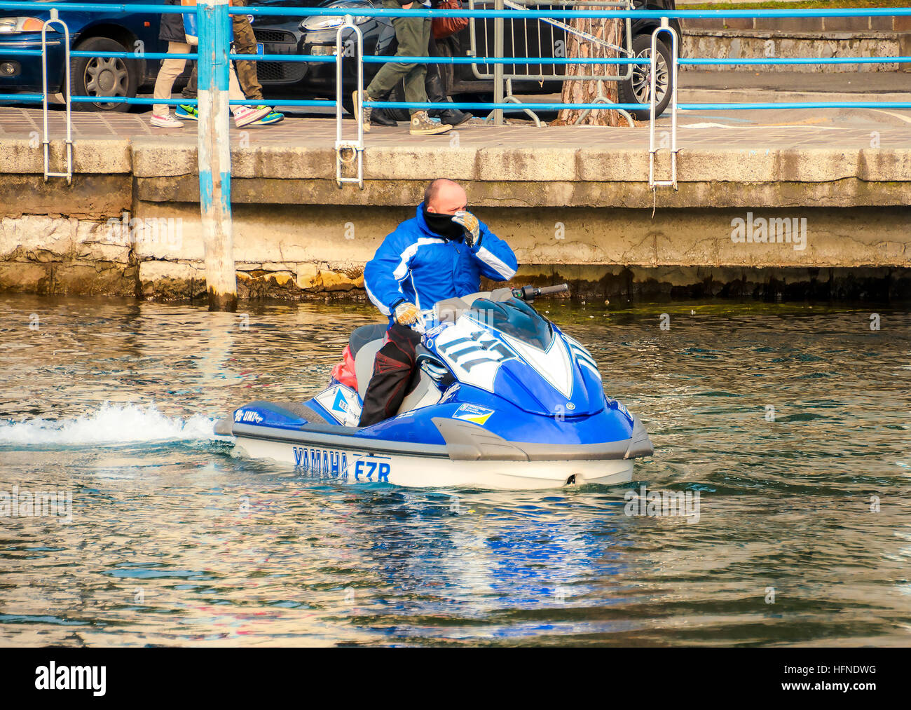 man on a blue ski jet watercraft in winter - Stock Image