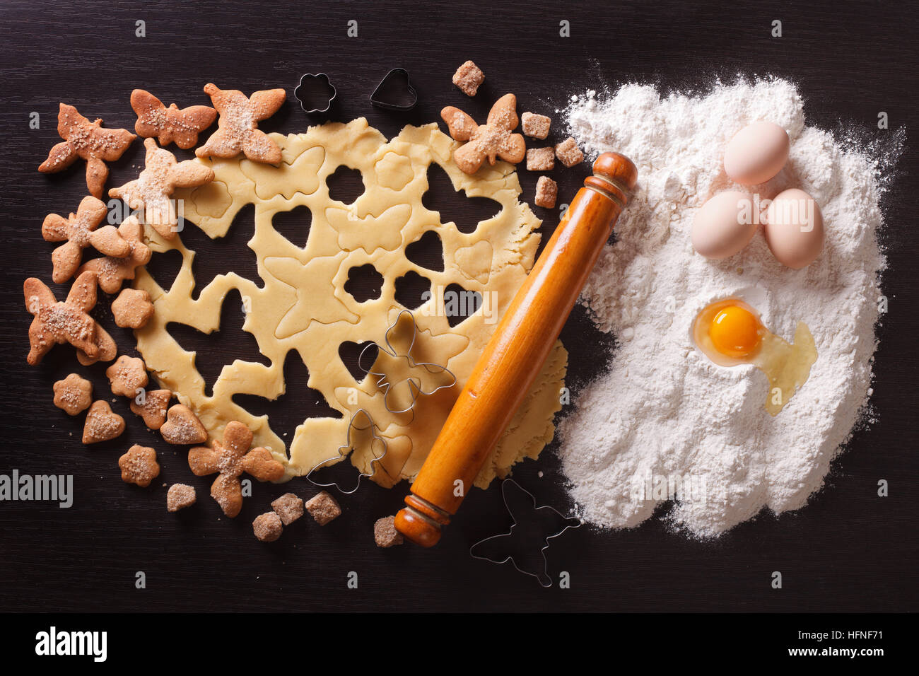 Cooking figure pastry on the table and ingredients. horizontal view from above - Stock Image