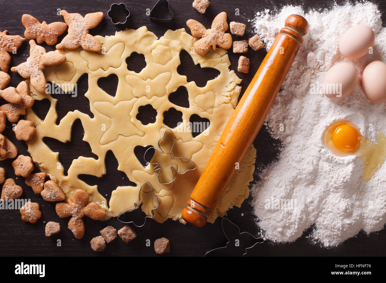 Cooking figure pastry close up on the table and ingredients. horizontal view from above - Stock Image