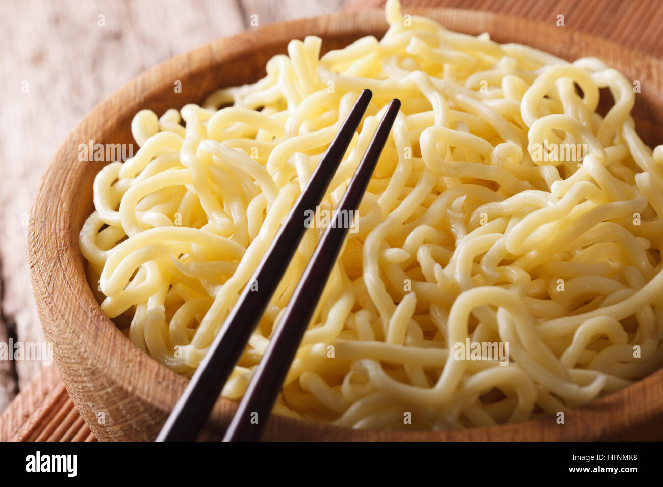 Traditional Asian ramen noodles in a wooden bowl macro. horizontal - Stock Image