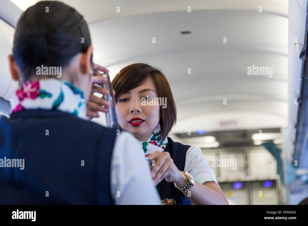 Cabin crew on Philippine Airlines flight from Manila - Stock Image