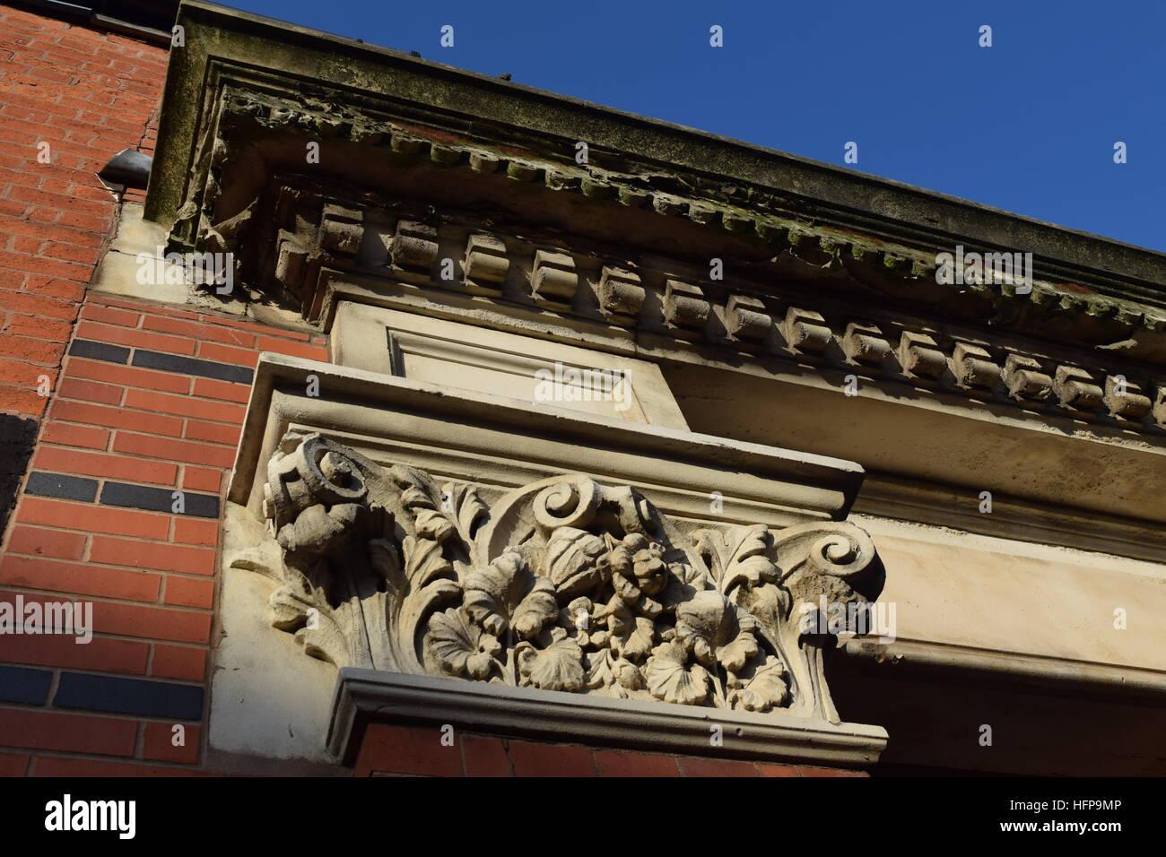 Decaying Corinthian capitals on a rectangular arch in Princip Street in Birmingham's Gun Quarter - Stock Image