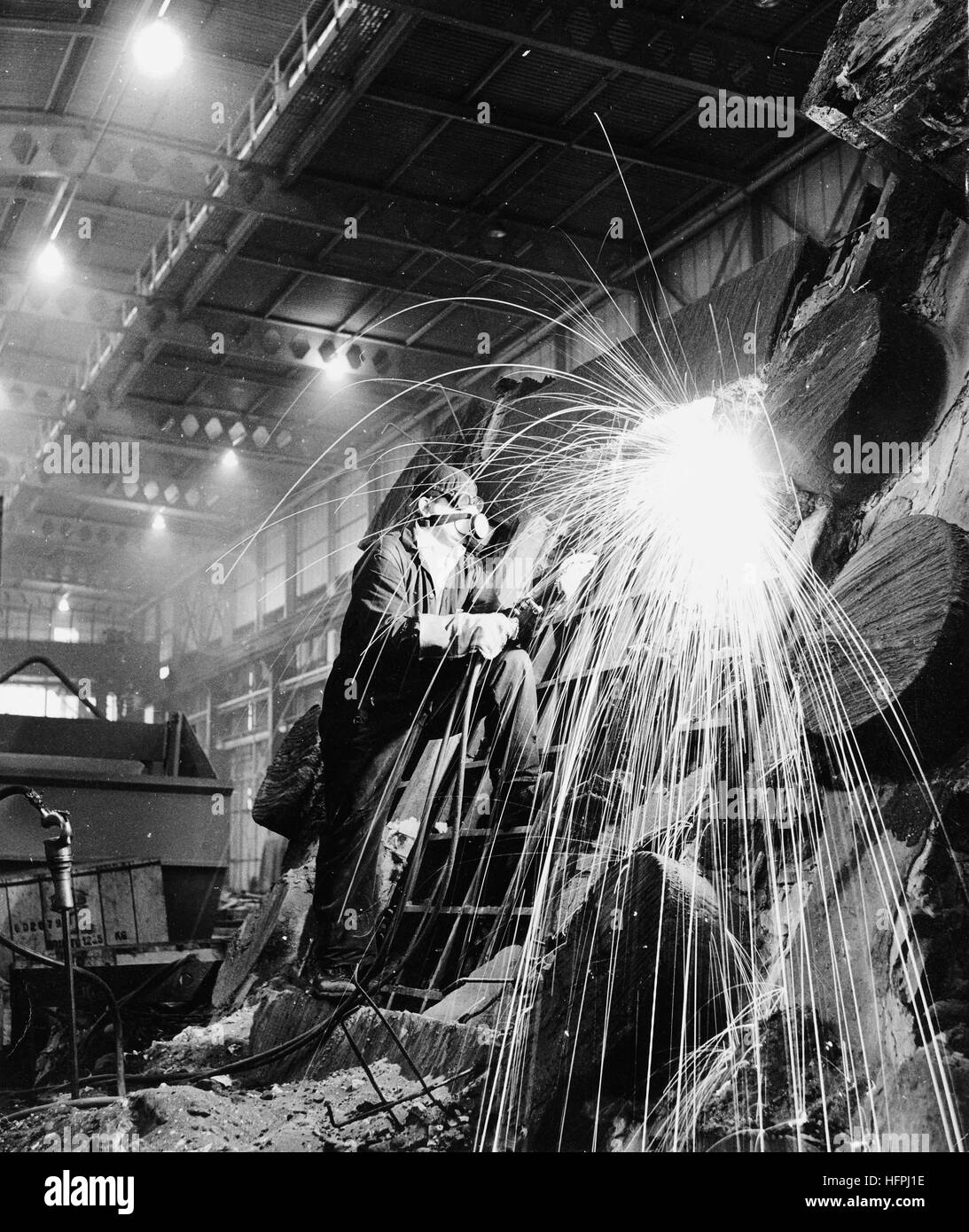 Flame cutting steel at F. H. Lloyd & Company Limited in Darlaston the West Midlands Uk 1964 - Stock Image