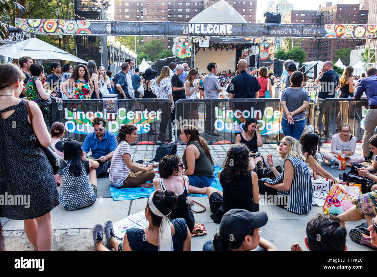 Manhattan New York City NYC NY Lincoln Square Lincoln Center Plaza PAC Out of Doors concert man woman sitting on - Stock Image