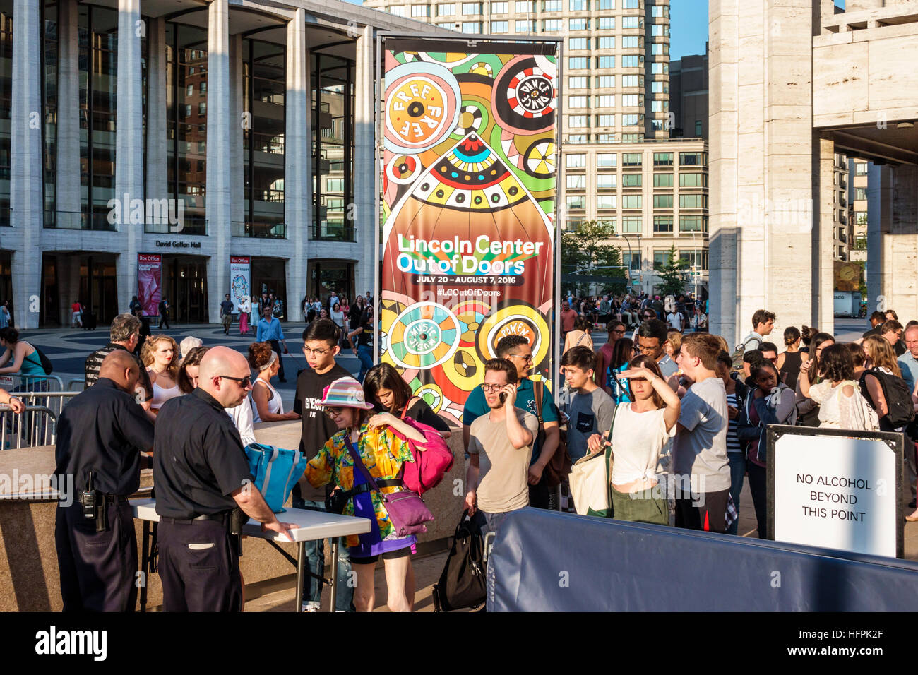 Manhattan New York City NYC NY Lincoln Square Lincoln Center Plaza PAC Out of Doors concert security guard bag check - Stock Image
