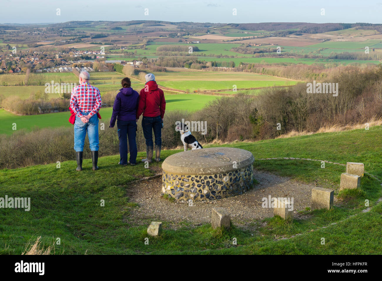 People looking at view of countryside by Wye Crown Millennium stone in Wye National Nature Reserve on North Downs - Stock Image