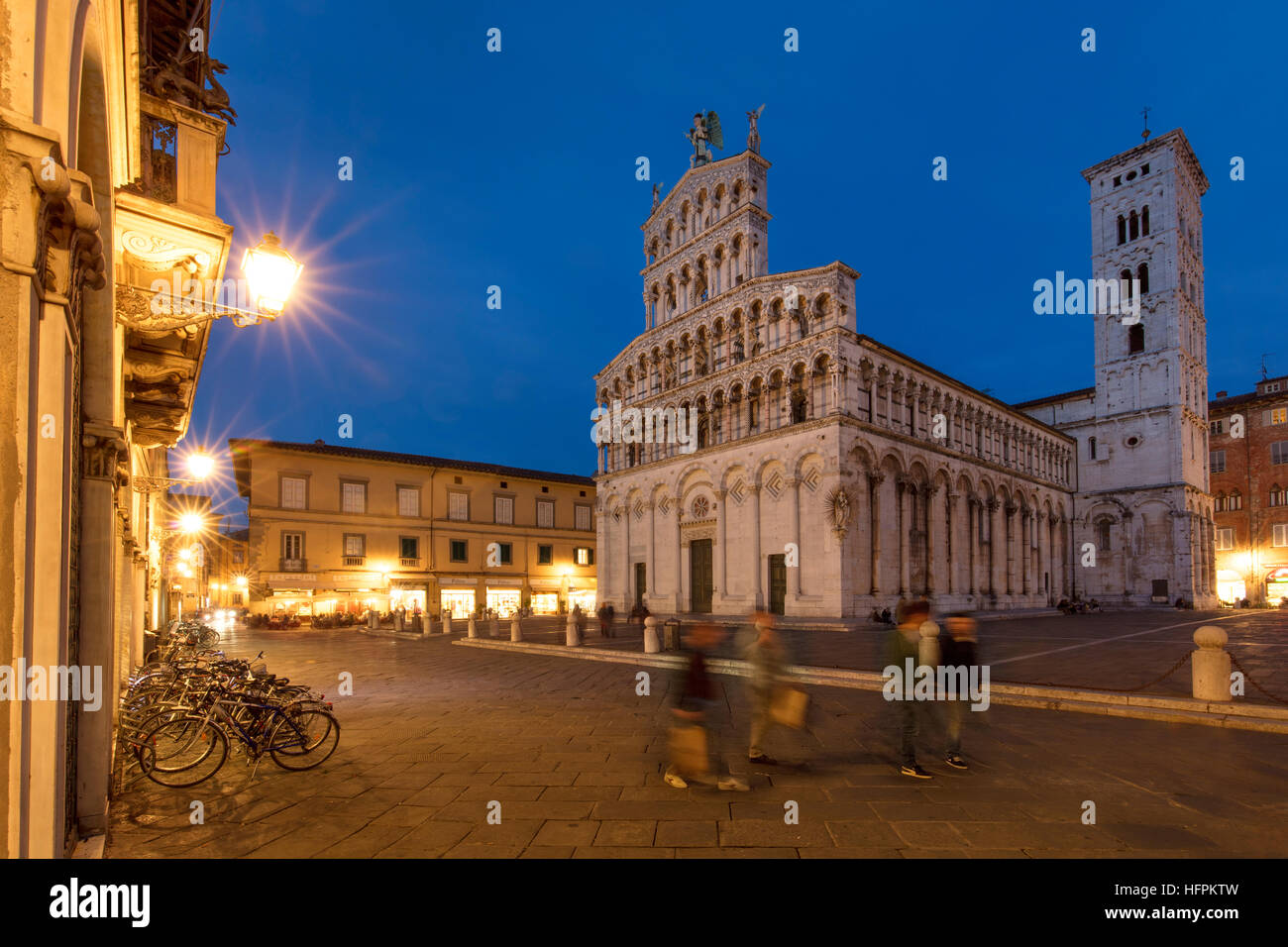 Twilight over Chiesa di San Michele and Piazza San Michele, Lucca, Tuscany Italy - Stock Image