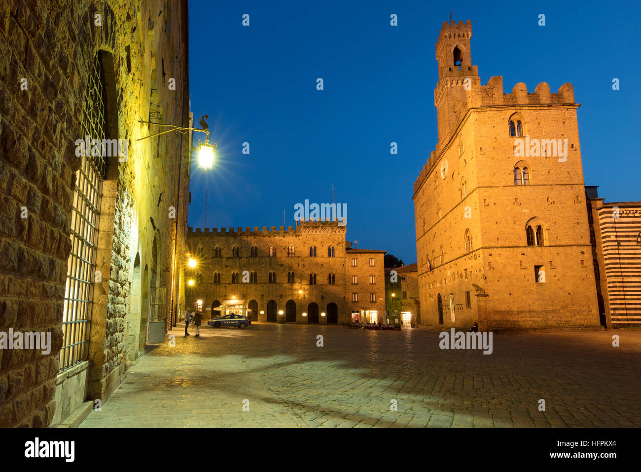Twilight over Palazzo dei Priori and the medieval town of Volterra, Tuscany, Italy - Stock Image