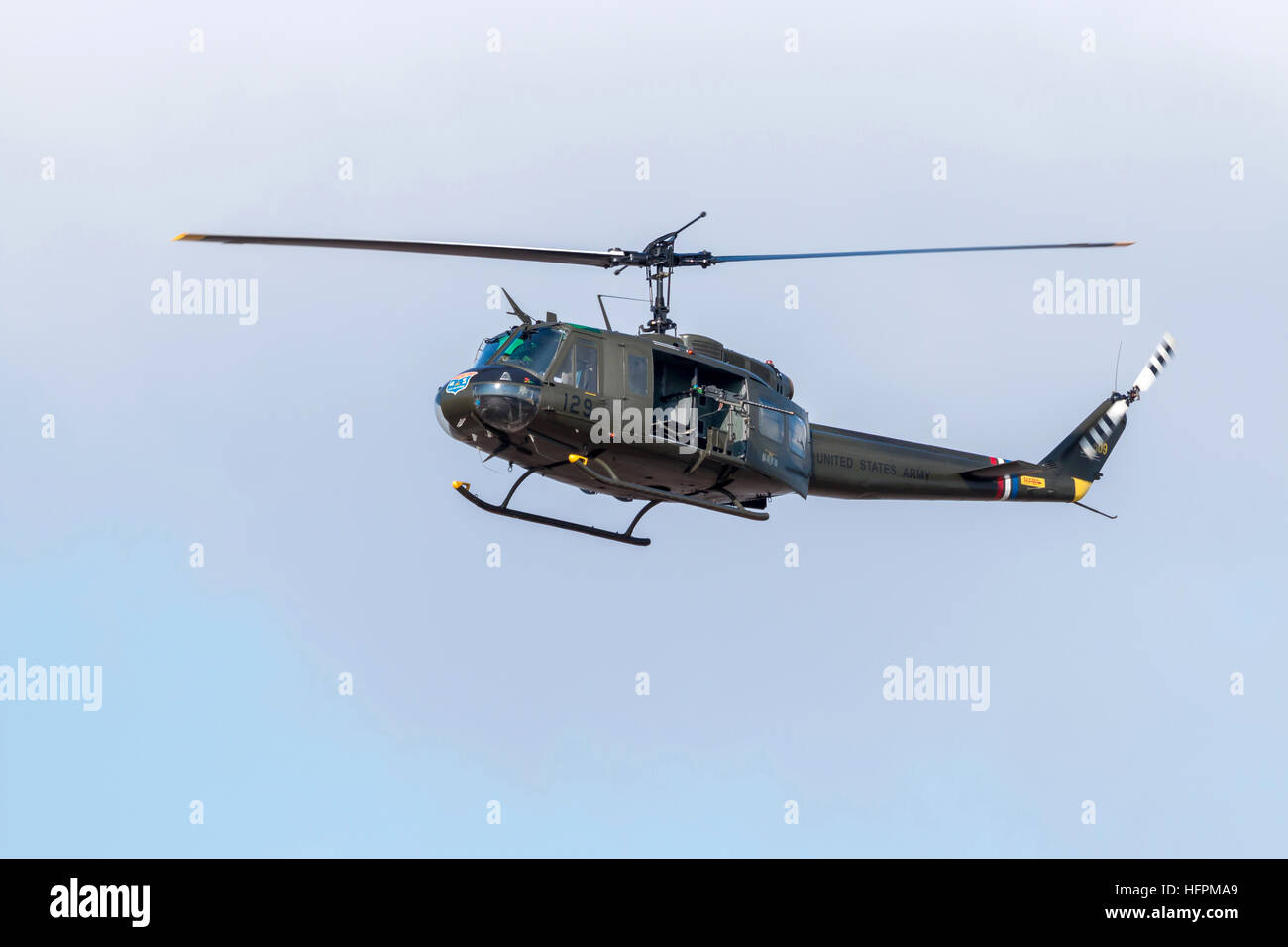 The Bell UH-1 Iroquois military helicopter, nicknamed the Huey displaying to the crowds at the Southport airshow - Stock Image