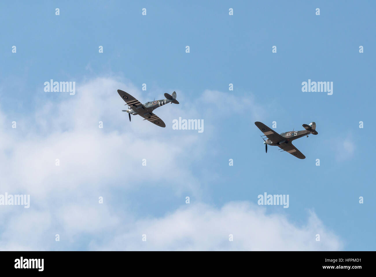 Vintage Supermarine Spitfire and Hawker Hurricane aircraft displaying against a blue sky background at the Southport - Stock Image
