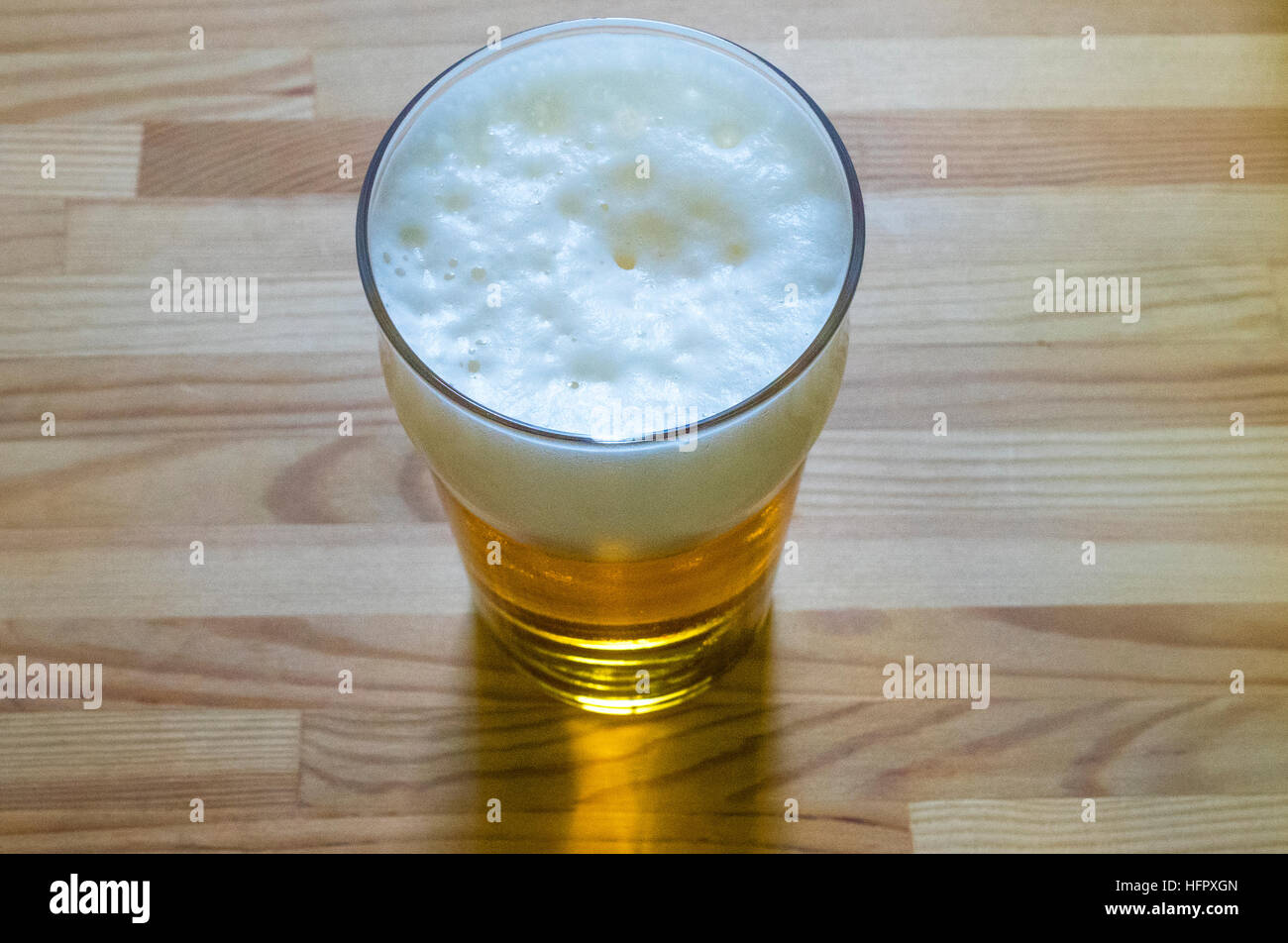 A pint of cool larger beer - Stock Image