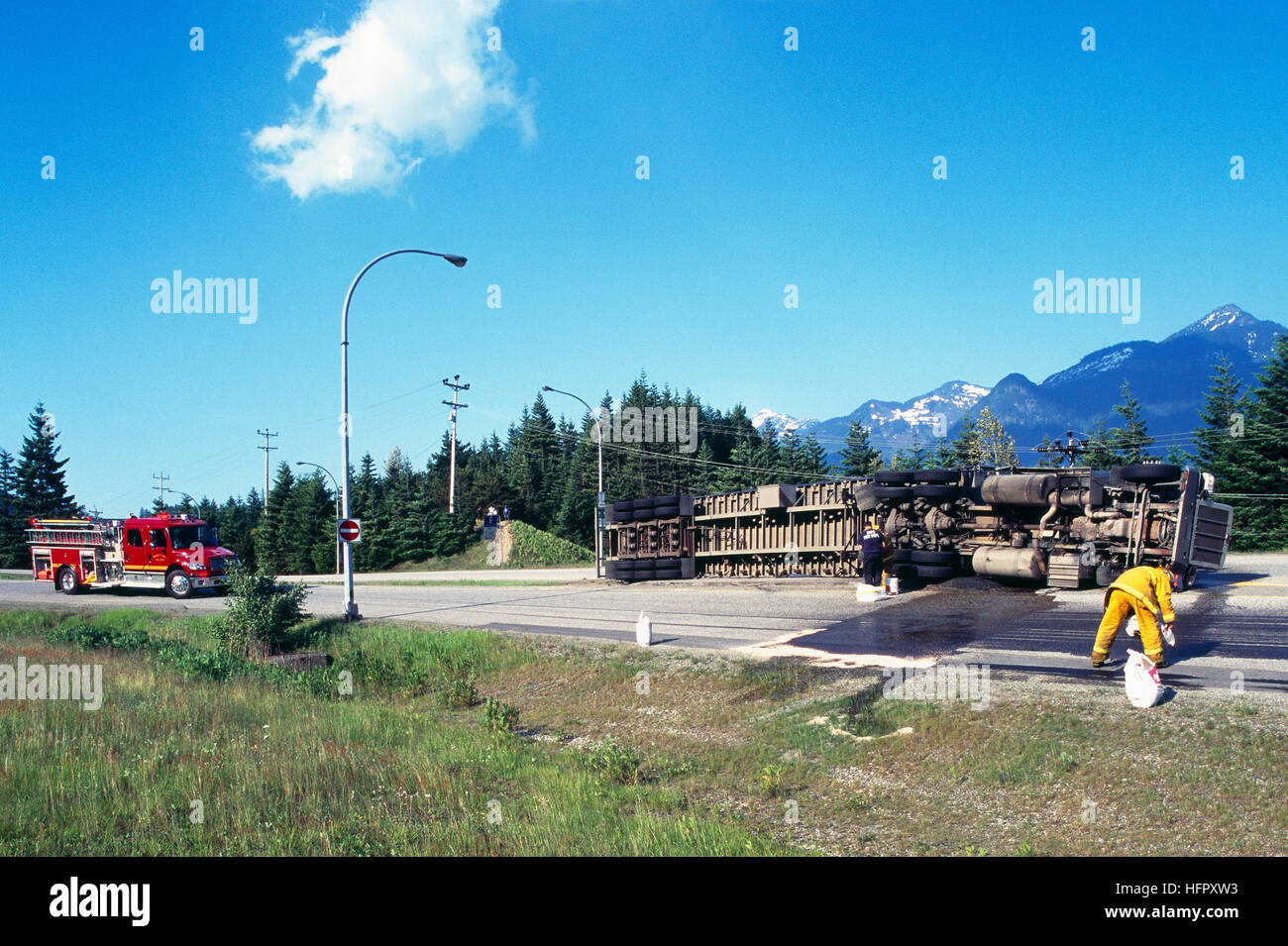 Highway Accident, Oil Spill Cleanup from Overturned Semi Trailer Truck, BC, British Columbia, Canada - Road Accidents - Stock Image