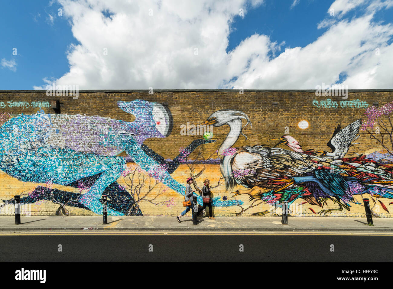 Shoreditch and Brick Lane creative graffiti and social art in east London, UK Stock Photo