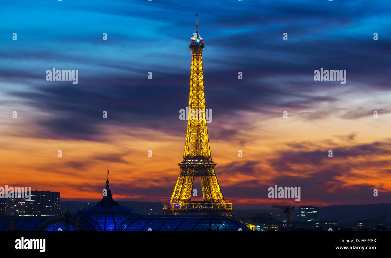 Paris, France-December 28; 2016 : The famous Eiffel tower at sunset.It is one of the most visited monuments in the - Stock Image