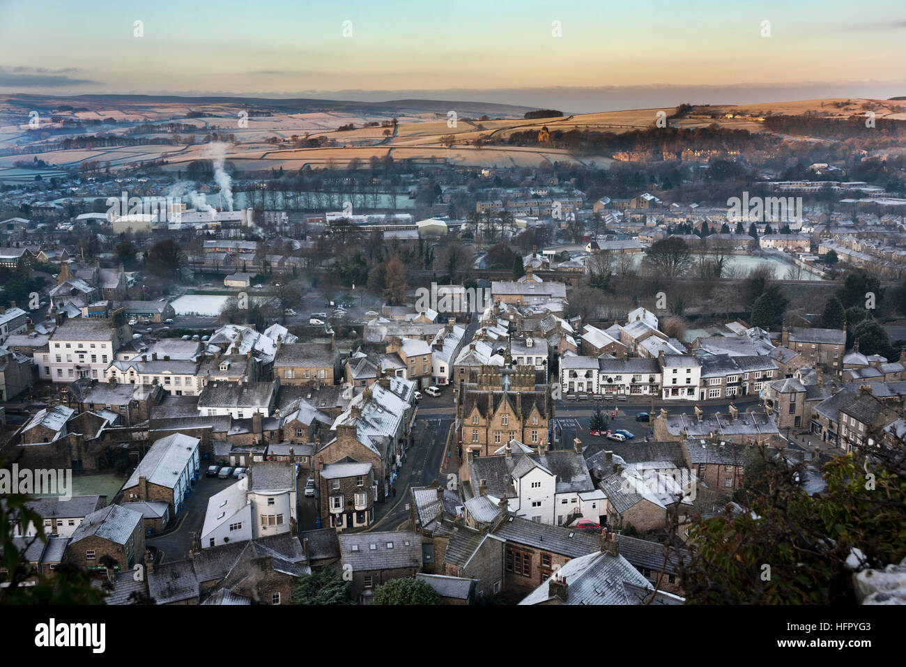 Frosty Winter morning, looking over the market town of Settle and village of Giggleswick, North Yorkshire, UK. - Stock Image