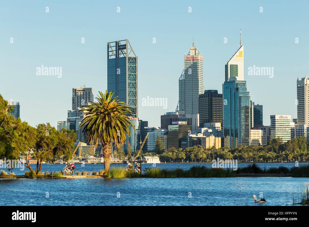 View across St James Mitchell Park and the Swan River to the city skyline at dawn, Perth, Western Australia, Australia - Stock Image
