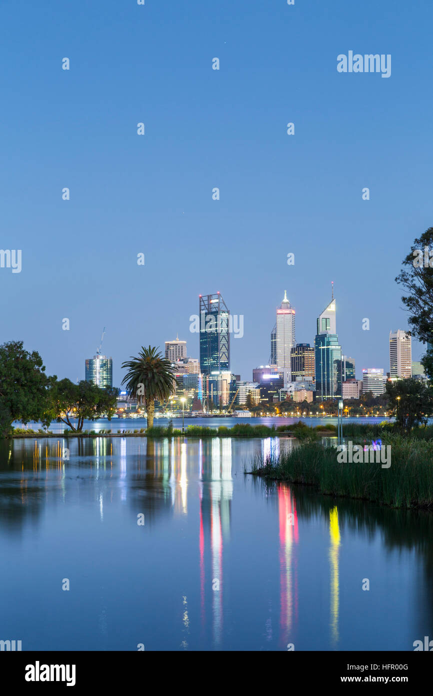 View across St James Mitchell Park and the Swan River to the city skyline at twilight, Perth, Western Australia, - Stock Image