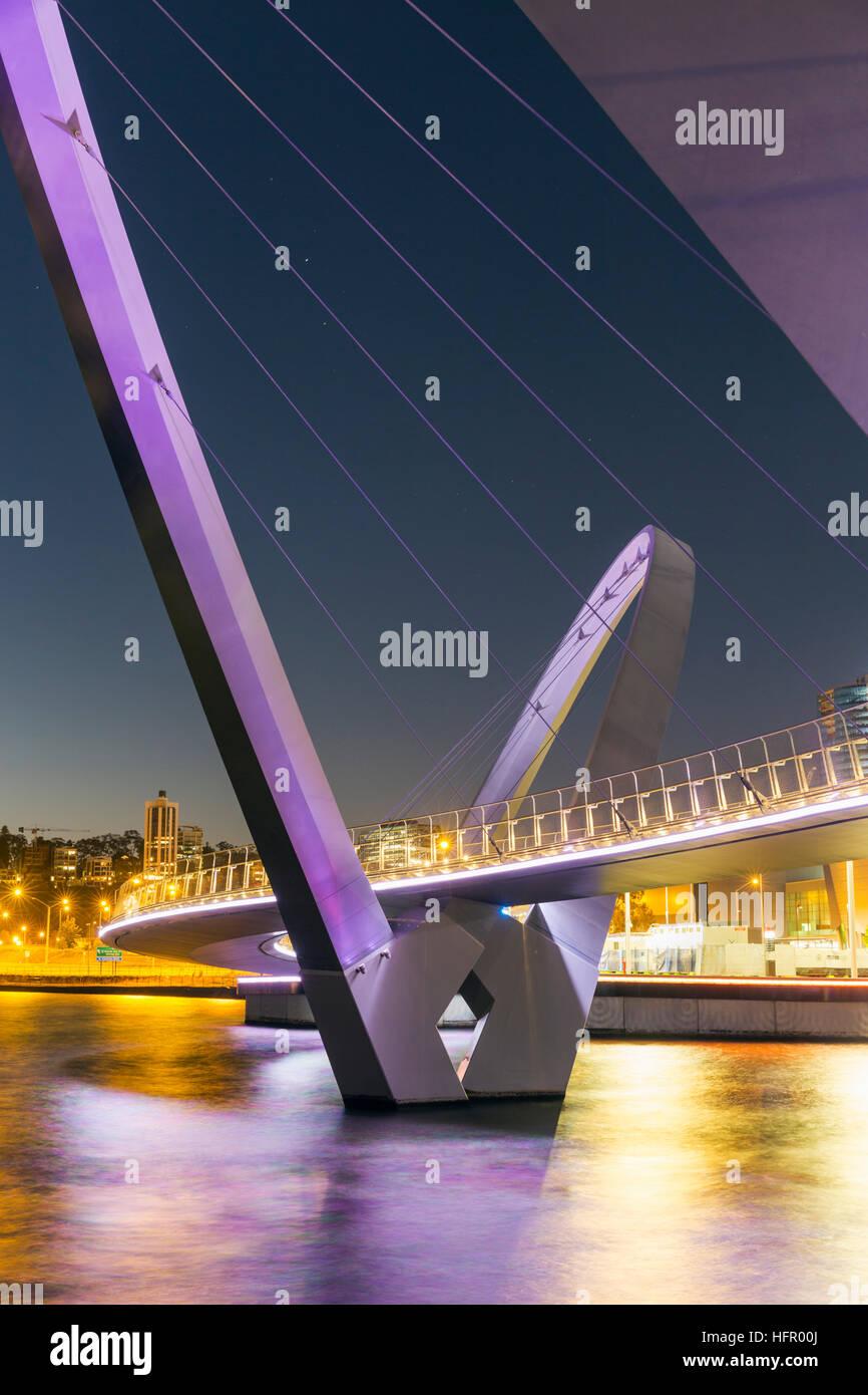 The Elizabeth Quay bridge on the Swan River illuminated at twilight, Perth, Western Australia, Australia - Stock Image