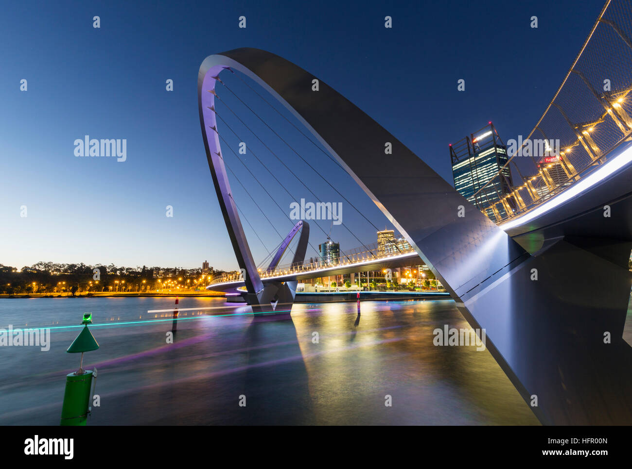 Ferry lights passing under the illuminated Elizabeth Quay bridge at twilight, Perth, Western Australia, Australia - Stock Image
