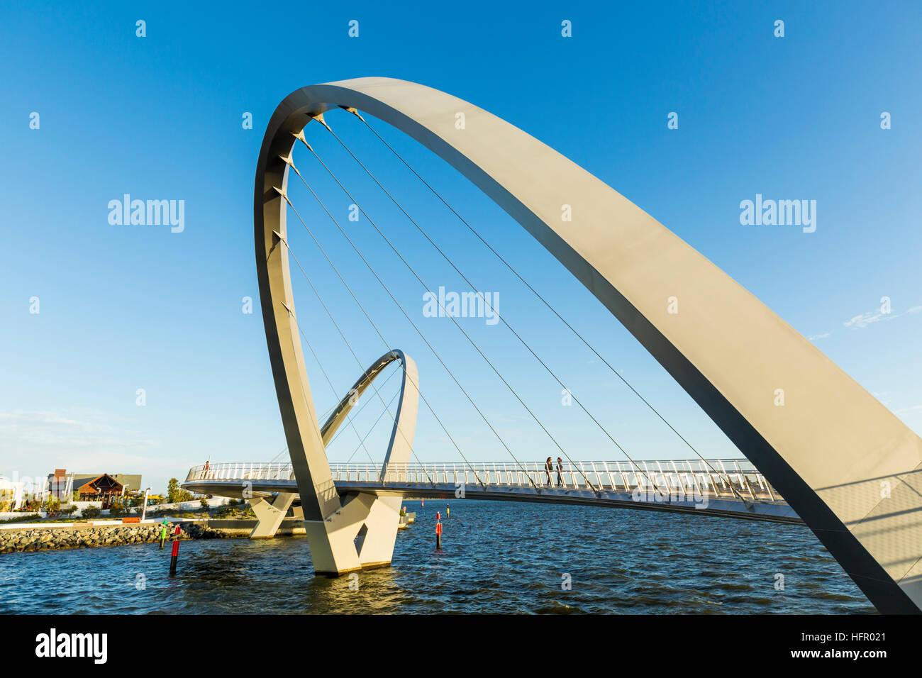 The Elizabeth Quay pedestrian bridge on the Swan River at sunset, Perth, Western Australia, Australia - Stock Image