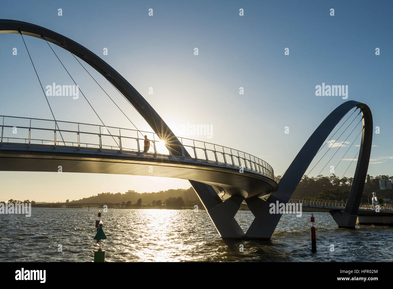 The Elizabeth Quay pedestrian bridge on the Swan River at sunset, Perth, Western Australia, Australia - Stock Image