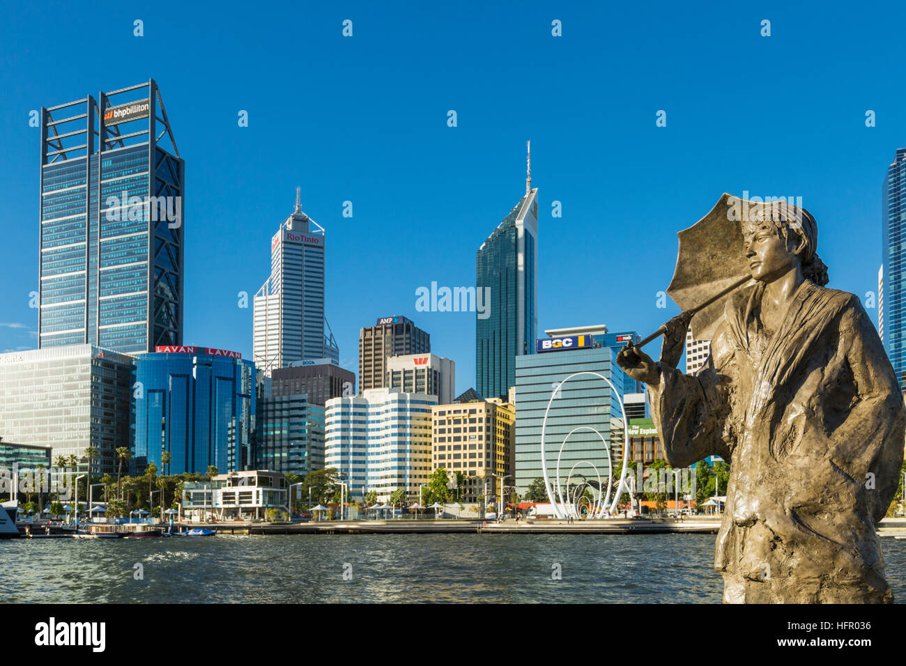 The Bessie Rischbieth Statue by artist Jon Tarry at Elizabeth Quay, with the city skyline beyond, Perth, Western - Stock Image