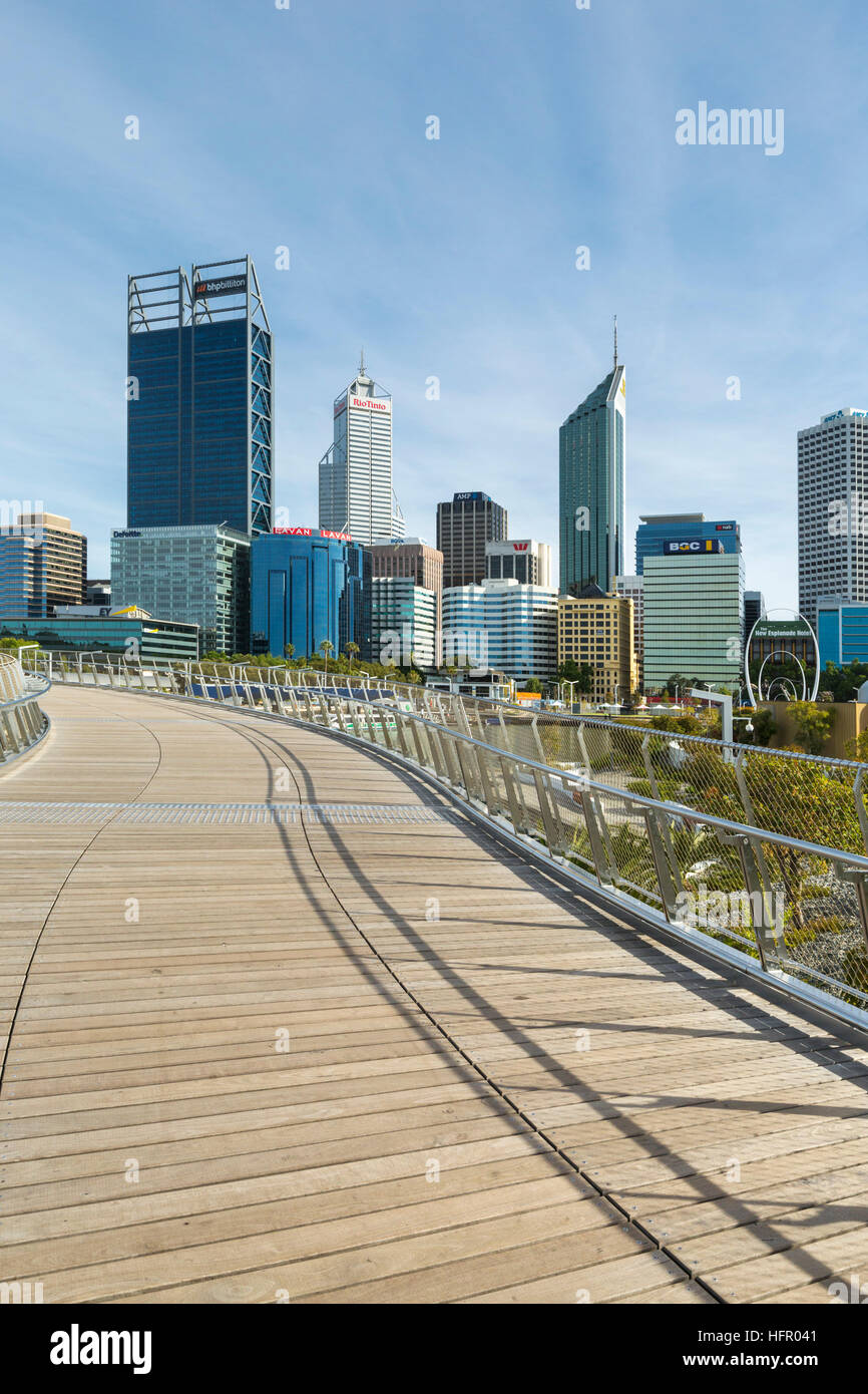 View along the Elizabeth Quay pedestrian bridge to the city skyline, Perth, Western Australia, Australia - Stock Image