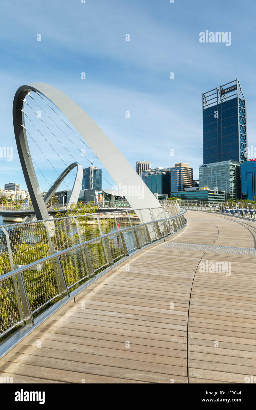 View along the Elizabeth Quay pedestrian bridge to the city skyline, Perth, Western Australia, Australia - Stock Image