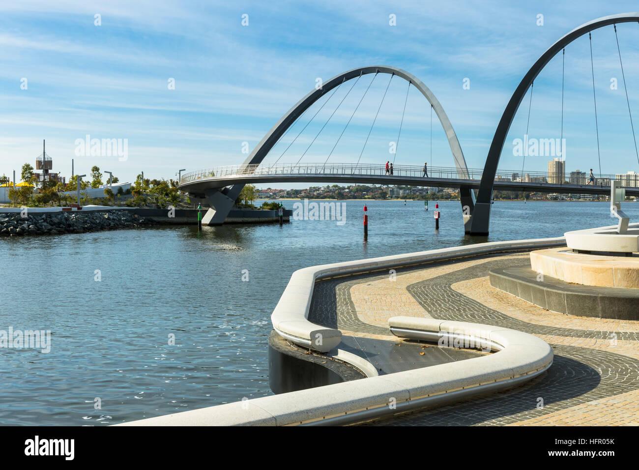 View along the promenade at Elizabeth Quay towards the pedestrian bridge, Perth, Western Australia, Australia Stock Photo