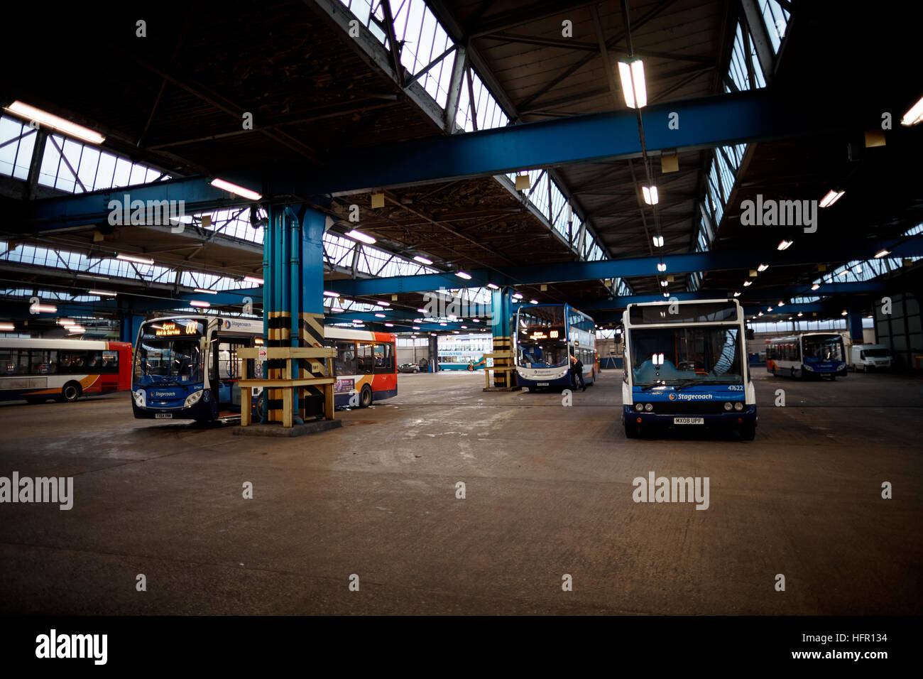 Stockport Bus Depot Stagecoach  Bus buses stopped double decker single fleet coach company livery route services - Stock Image