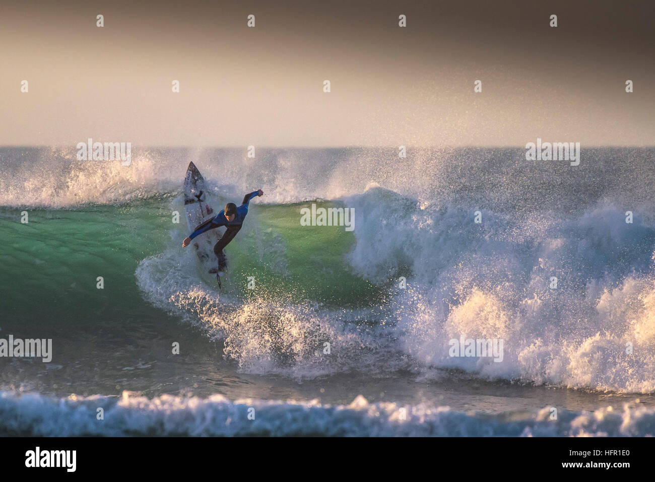 Exhilarating surfing action action at Fistral in Newquay, Cornwall, England. UK. - Stock Image