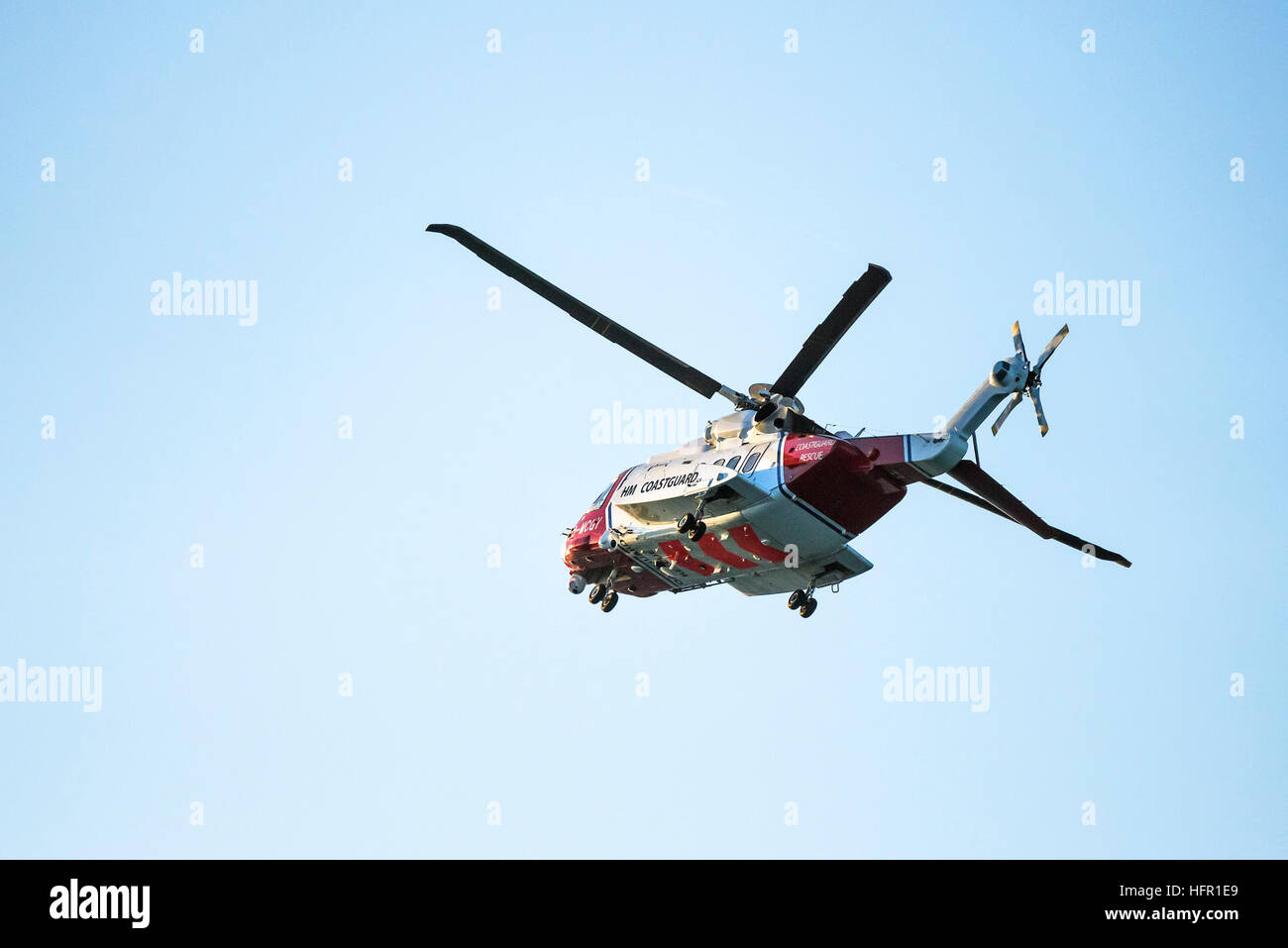 A Sikorsky S-92A HM Coastguard SAR Helicopter G-MCGY operated by Bristol Helicopters flies overhead on the North - Stock Image