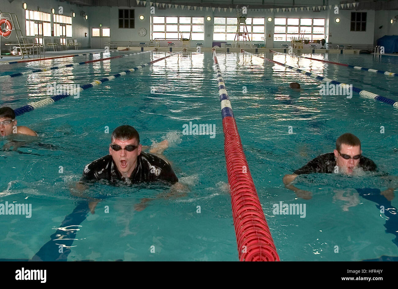 070411-N-2638R-001 YOKOSUKA, Japan (April 11, 2007) - Search and rescue (SAR) swimmers swim laps during training - Stock Image